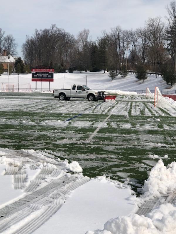 SPS clearing snow from area athletic turf fields and rubberized tracks.